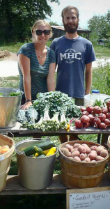 Trish and John from Sandhill Farms selling their produce at the Dancing Rabbit Ecovillage farmer's market.