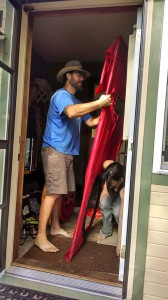 Bear and Jennifer wrestle the blower door into place. Photo by Tereza.