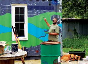 The shipping-container grocery store gets the first coat of its new mural. Photo by Alline.
