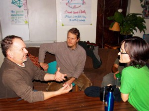 "Trainer Tom (left) speaks passionately to Ted and Tereza about improving connection using ""Matrix"" methods during a Retreat break. Photo by Dennis."