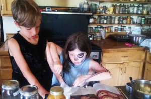 Max and Emma making cookies in their new co-op kitchen. Photo by Christina.