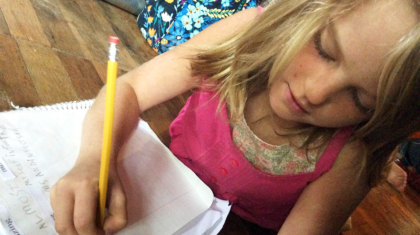 Althea works on a poem in homeschool. Photo by Christina.