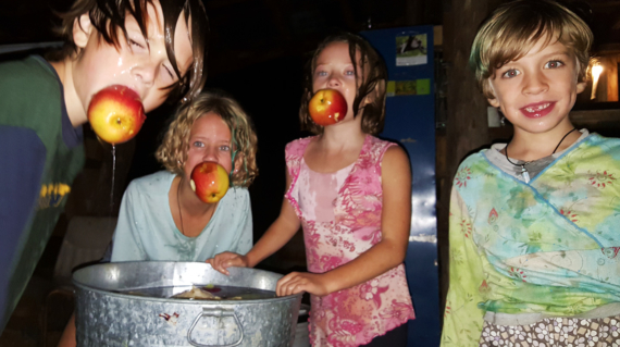 The kids bobbing for apples during the Hollerween fiasco! Photo by Aaron.