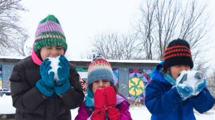 Girls eating snowcrop