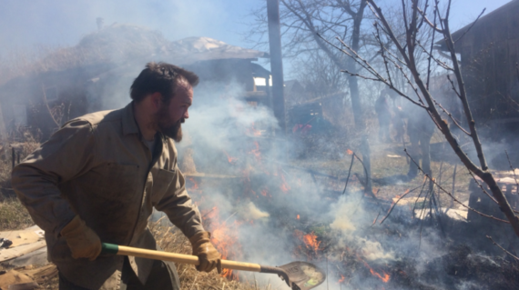 Benji managing the controlled burn in the garden at Bluestem on March 14, 2018. Photo by Caleb.