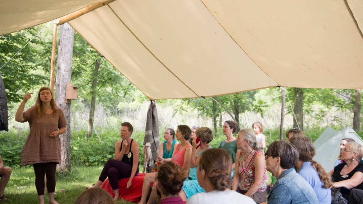 Village Fire pic of Annie Zylstra teaching. photo by Yushi Zhang