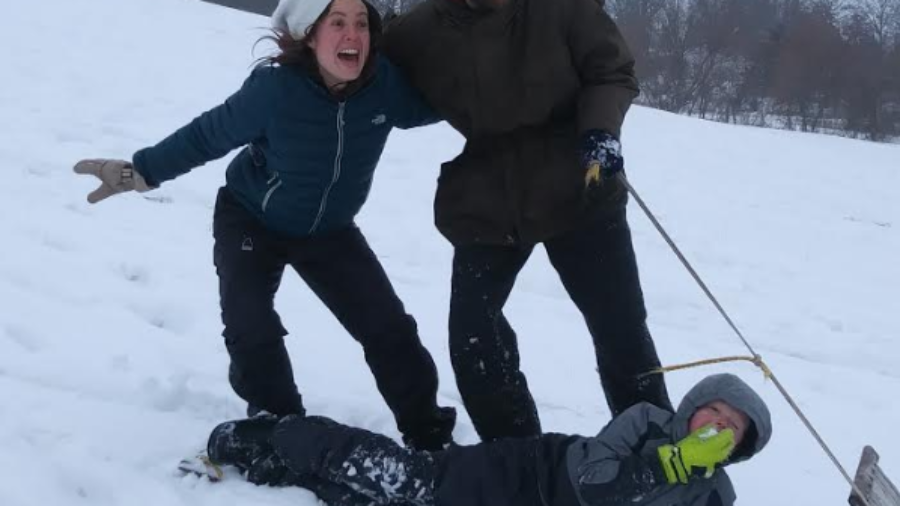 Some Rabbits sledding on the Vista de la Moo. From left to right: Alannah, Hassan, and Ezra stuffing his face with snow.