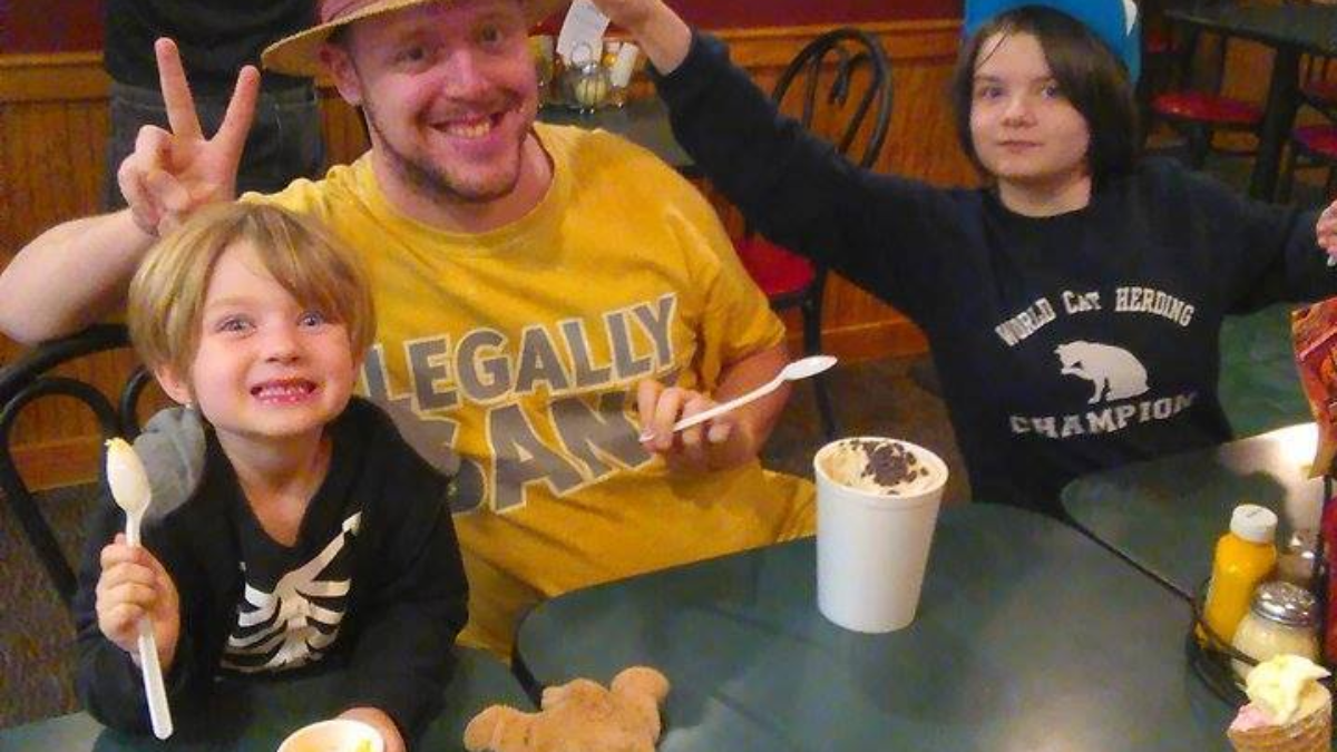 Vick chowing down on some ice cream with two of his youngest friends.