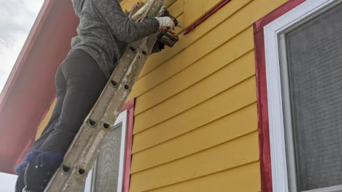 Prairie installed a thermal covering over a vent in our community house of culture, to keep out the cold.