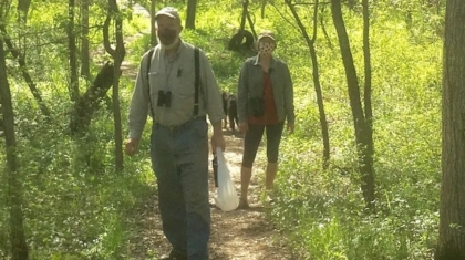 Kurt and Alyson on a walk through the woods to do some bird watching.