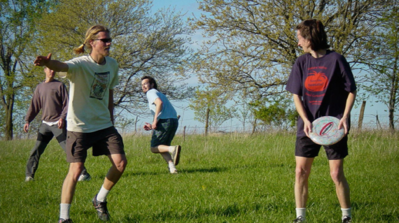A group of friends playing a game of Ultimate Frisbee.
